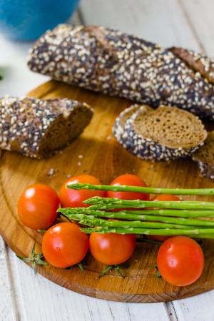 Fresh asparagus, bread and tomatoes