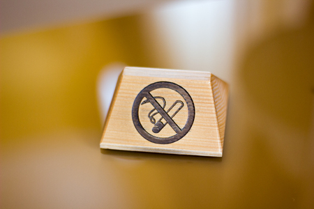 Nameplate with no smoking sign over the table. Stock Photo