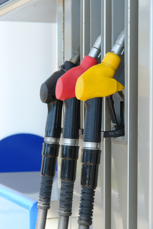 Fuel pump on gas station. Three fuel nozzles. Stock Photo