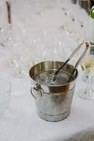 Cold ice in a bucket. Ice Bucket with tranparent cubes of ice