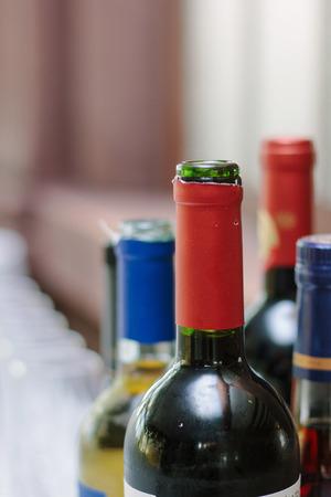 Bottle necks of bottles at restaurant