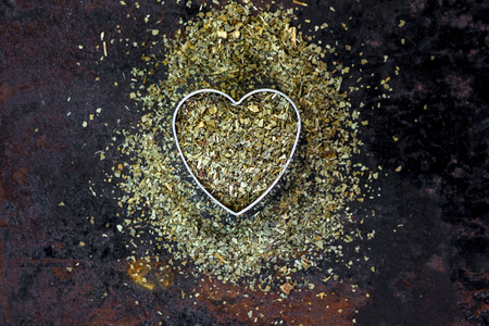Heart made from yerba mate - dry leaves ready to cook mate tea