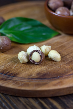 Macadamia nuts on a wooden kitchen board Stock Photo