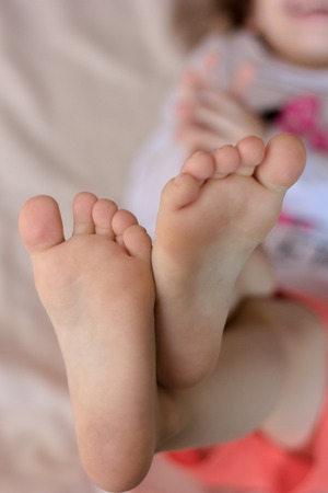 Kids toes and heels. Baby shows foots Stock Photo