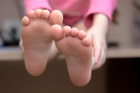 Kids toes and heels. Baby shows foots Stockfoto