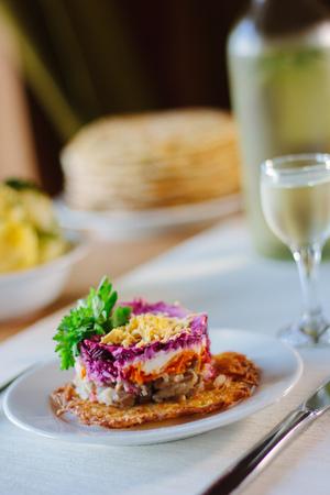 Fresh beet salad at a restaurant table.