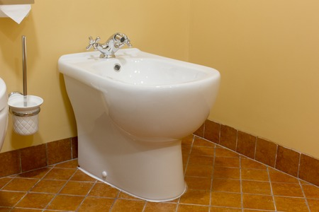 White ceramic bidet in a modern bathroom.