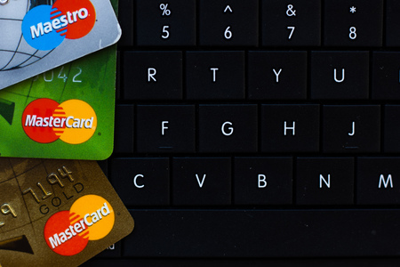 Ryazan, Russia - February 27, 2018: Few credit cards of Mastercard company over the black computer keyboard Editorial