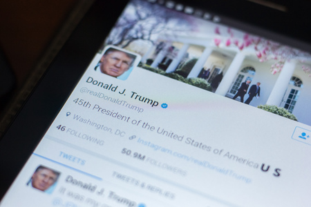Ryazan, Russia - April 19, 2018 - Donald Trump, USA president twitter account on the display of tablet PC