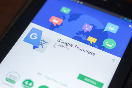Ryazan, Russia - April 19, 2018 - Google Translate mobile app on the display of tablet PC