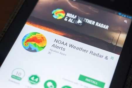Ryazan, Russia - April 19, 2018 - NOAA Weather Radar and Alerts mobile app on the display of tablet PC