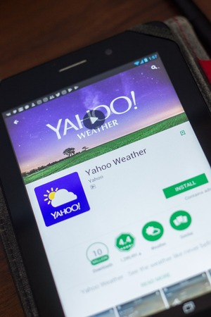 Ryazan, Russia - May 16, 2018: Yahoo Weather mobile app on the display of tablet PC