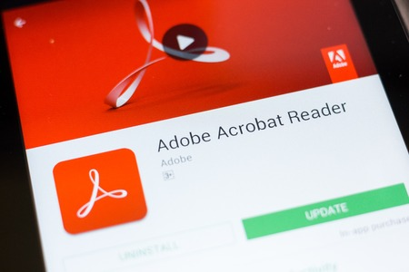 Ryazan, Russia - June 24, 2018: Adobe Acrobat Reader mobile app on the display of tablet PC 報道画像