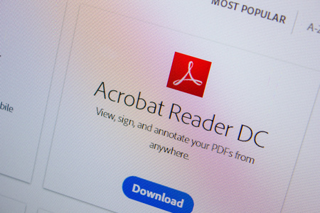 Ryazan, Russia - July 11, 2018: Adobe Acrobat Reader, software logo on the official website of Adobe