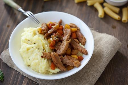 Soy meat with potato puree over kitchen table Reklamní fotografie