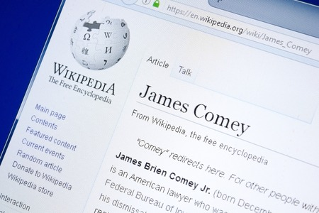 Ryazan, Russia - August 28, 2018: Wikipedia page about James Comey on the display of PC 에디토리얼