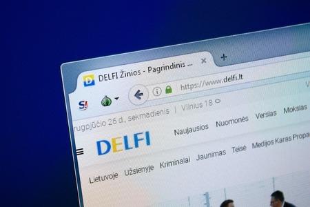 Ryazan, Russia - August 26, 2018: Homepage of Delfi website on the display of PC, Url - Delfi.lt. Sajtókép