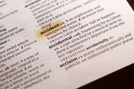 The word or phrase Accident in a dictionary highlighted with marker. Фото со стока