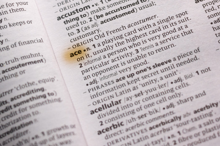 The word or phrase Ace in a dictionary highlighted with marker. Foto de archivo