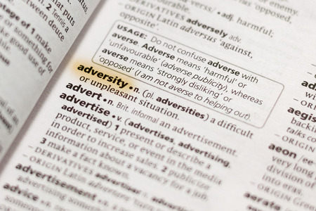 The word or phrase Adversity in a dictionary highlighted with marker. 写真素材