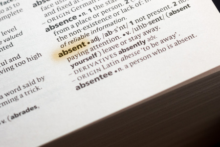 The word or phrase Absent in a dictionary highlighted with marker. 写真素材