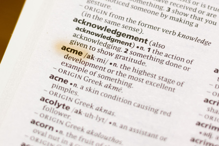 The word or phrase Acme in a dictionary highlighted with marker.