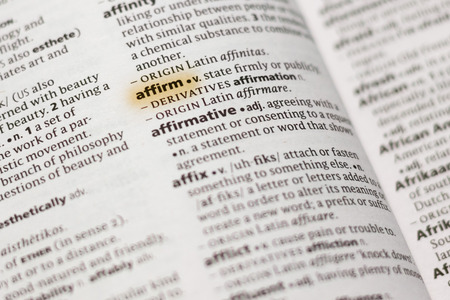 The word or phrase Affirm in a dictionary highlighted with marker.