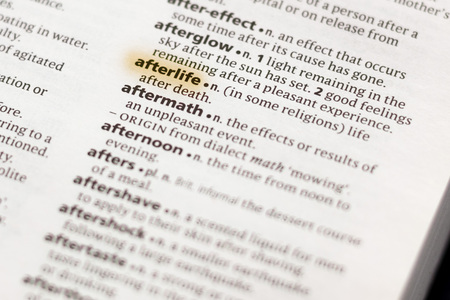 The word or phrase Afterlife in a dictionary highlighted with marker.