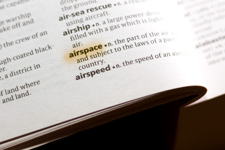 The word or phrase Airspace in a dictionary highlighted with marker.