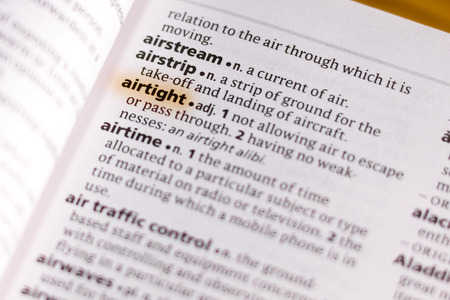 The word or phrase Airtight in a dictionary highlighted with marker.