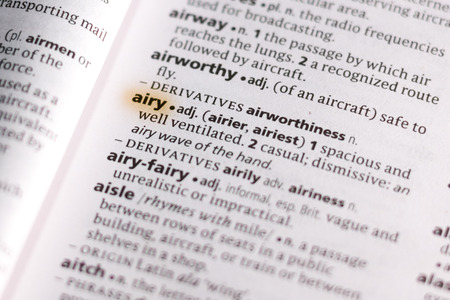 The word or phrase Airy in a dictionary highlighted with marker.