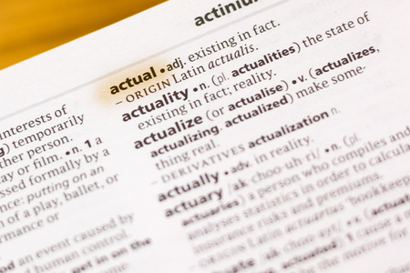 The word or phrase Actual in a dictionary highlighted with marker. Stock fotó
