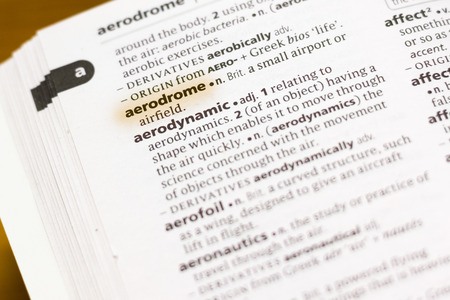The word or phrase Aerodrome in a dictionary highlighted with marker.