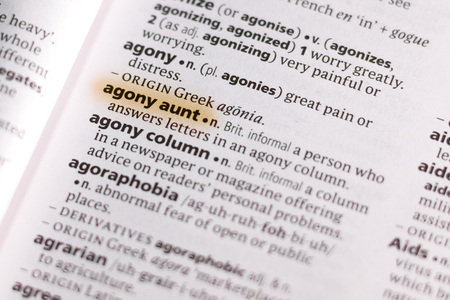 The word or phrase Agony Aunt in a dictionary highlighted with marker.