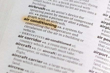 The word or phrase Air Conditioning in a dictionary highlighted with marker.