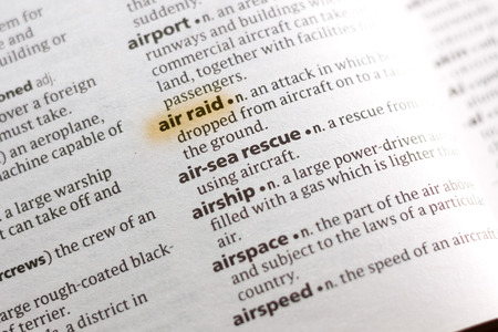 The word or phrase Air Raid in a dictionary highlighted with marker.