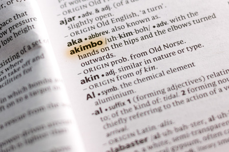 The word or phrase Akimbo in a dictionary highlighted with marker.