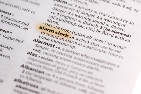 The word or phrase Alarm Clock in a dictionary highlighted with marker. 写真素材