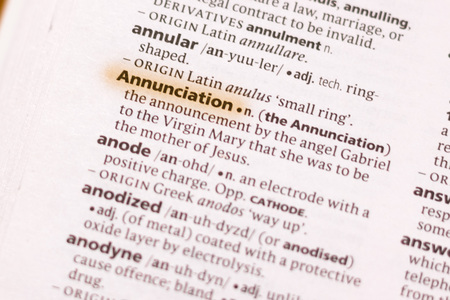 The word or phrase Annunciation in a dictionary highlighted with marker.