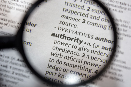 The word of phrase authority in a dictionary.