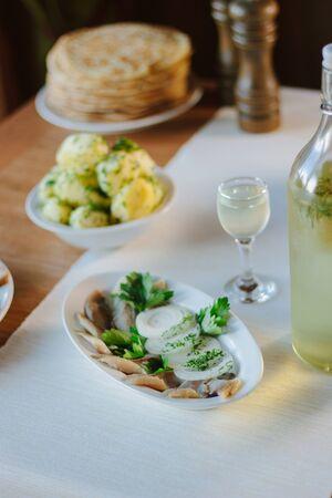 Salty herring on restaurant table - nice food. Standard-Bild - 124720243