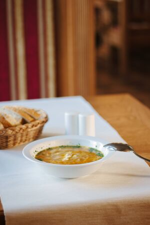 Nice vegetable soup at the table of restaurant Standard-Bild - 124720285