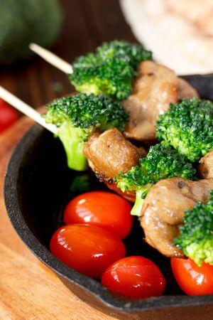 Vegan kebabs with seitan and broccoli on wooden skewers Standard-Bild - 124720289