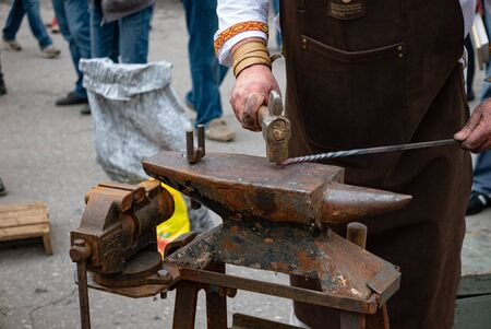 Ryazan, Russia - July 27, 2019: Blacksmith with hammer on street festival.