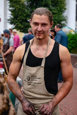 Ryazan, Russia - July 27, 2019: Young blacksmith on the street festival