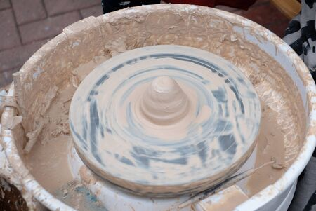 Cone of clay on the pottery wheel ready for forming.