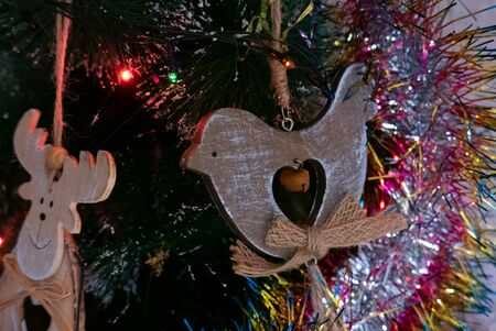 Wooden dove toy on the christmas tree
