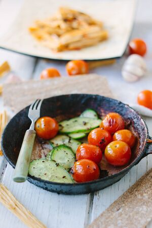 Fresh and juicy roasted tomatoes and cucumbers