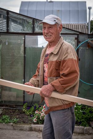 Ryazan, Russia - July 27, 2019: Senior farmer in a Russia.