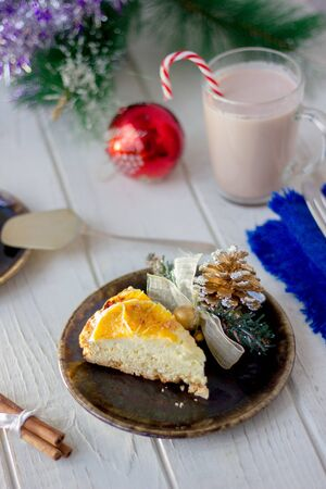 Piece of christmas cake ready to eat on rustic plate 写真素材